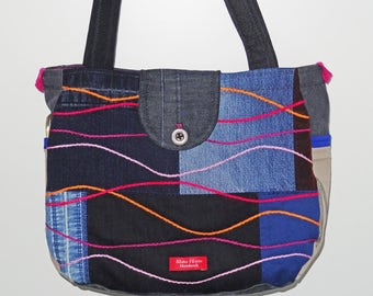 Shoulder bag with extra strap