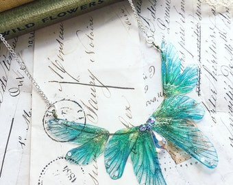 NEW Beautiful delicate sea blue and green rainbow faerie winged necklace