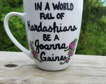 "Hand painted coffee/tea/hot chocolate mug, with ""In a world full of Kardashians, be a Joanna Gaines"""