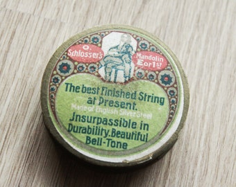 Small antique round cardboard box Schlosser's, vintage, contained strings of mandolin