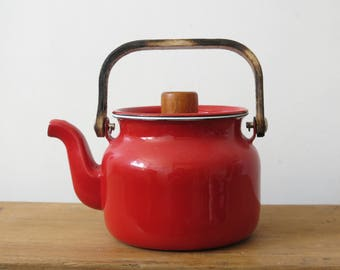 Red teapot in vintage enamel