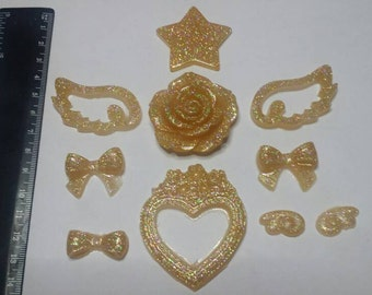 Set of Golden resin cabochons, with pink, bows and cameo heart