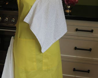 Baby shower gift! Handmade, unique, full-length, yellow cotton drill maternity apron with 2 white face washers, 2 pockets & 2 brown buttons.