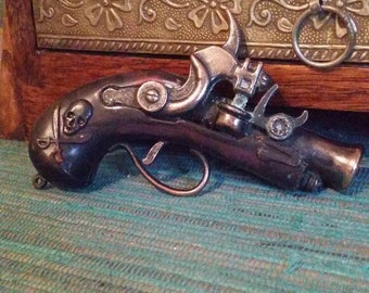 Vintage toy pirate cap gun, die cast