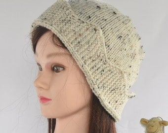 Lady's knitted hat - beanie style with a crown-edged turnup - natural colour with brown flecks (version 2)