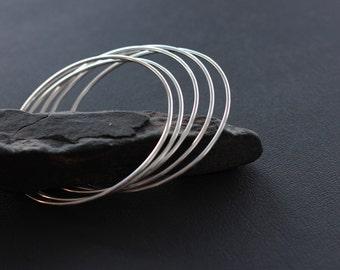 """Solid Sterling Silver Bangle Bracelet. Stackable Bangle Bracelet. """"Revolve Bracelet""""."""