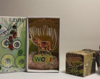 """Art box diorama pièce unique réalisé dans une boîte d'allumette.""""Le Loup"""".Assemblage matchbox."""