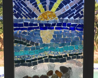 Stained glass mosaic suncatcher with ocean sunrise and seashells