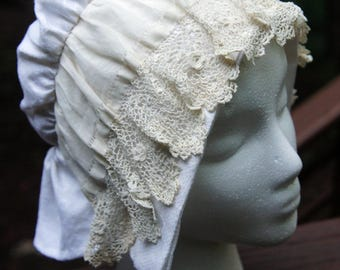 reproduction Victorian day bonnet constructed of antique linen and lace