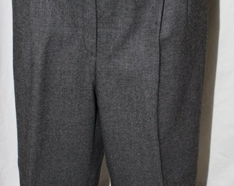 Grey Flannel Pants by Zanella. 100% Wool with pleats made in Italy. Great staple piece for the wardrobe and business wear