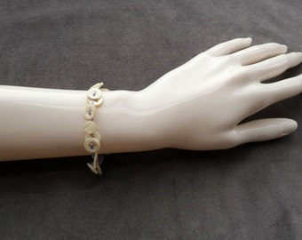 Lavender Bracelet with small vintage shell buttons