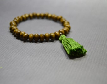 Wooden tassel bracelet / greenery colored tassel bracelet / brown wooden beaded jewelry / tribal timber jewelry / gift for women