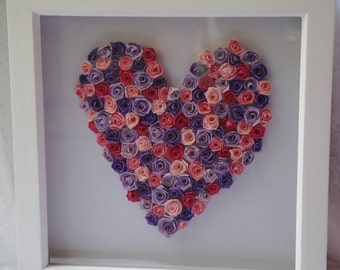 Beautiful quilled roses in the shape of a heart in shades of pink and lilac