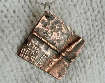 Fold formed hammered copper textured pendant