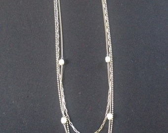 Elegant long flapper style necklace, metallic with faux pearl like beads