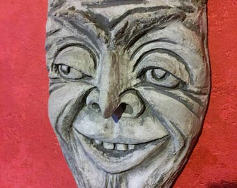 grotesque , wall plaque ,