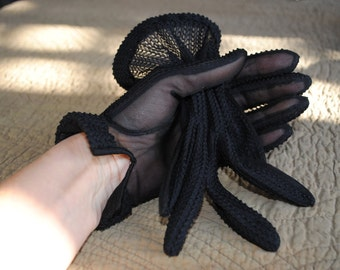 Pair of black gloves 1960