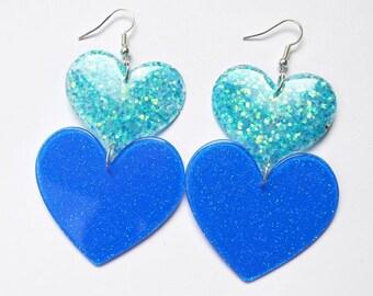 Double heart drop earrings blue glitter