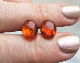 Pretty little vintage studs with natural Baltic sea amber