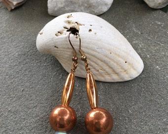 Copper colored beaded drop earrings