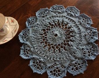 Set of three powder blue crocheted doilies. Handmade with love.