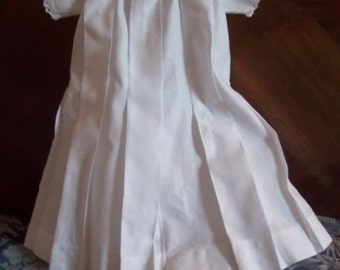 A pretty little old dress of small child size