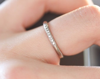 18ct white gold wedding ring with 9 pave set diamonds. UK size M. 18ct white gold eternity ring with G Si diamonds.