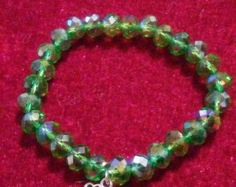 Bracelet of Green AB crystals  with a four leaf clover charm