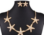 VINTAGE gold tone star fish necklace with crystals and post earrings