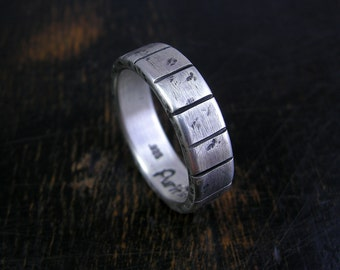 Made to order sterling silver band with rustic finish and stripes. 6mm wide with antique patina