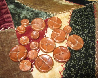 Sixteen Brown Leather buttons. BU40