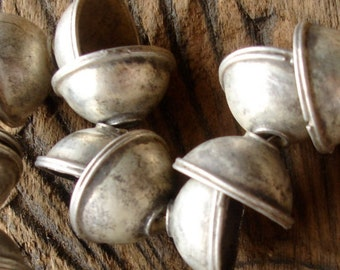 Moroccan tarnished yet shiny medium plain  round bead  made of two separate halves