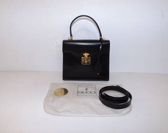 Vintage 1980s Gucci black leather kelly bag designer handbag with detachable shoulder strap mirror and dust cover working lock and key