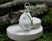 SOJ-097: Sterling Silver and Glass Oval Locket  - Double sided memory locket