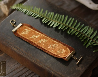 layered leather bracelet with handpainted leaves