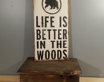 Life is Better in the Woods, circle with BEAR, hand painted, distressed, wooden sign.  blue with white and black