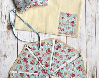 Summer bunting placemats and coasters. Summer lifestyle Outdoor dining. Handmade coasters. Handmade fabric bunting. Picnic placemat set