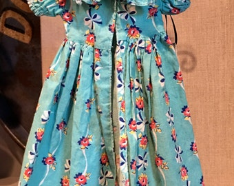 Doll dress, vintage1950, blue background, bows and flowers