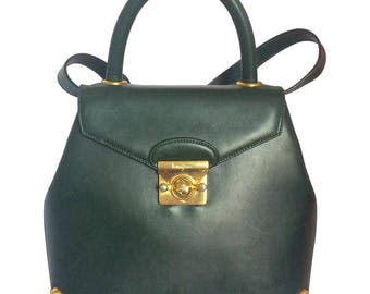 Vintage Salvatore Ferragamo deep green leather bag with gold tone logo and shoe motif closure.