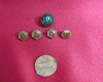 Antique small brown glass buttons x 4; one round green glass button; 1930's