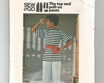 4765 Butterick Sewing Pattern Bateau Neck Semi Fitted Top Straight Legged Pants UNCUT Size Small 8/10