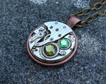 Steampunk Necklace, Featuring a Swiss Watch Movement & Green Swarovski Crystals.