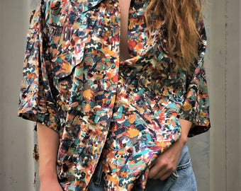 Vintage 90's 100% silk abstract print short sleeved button-down shirt...