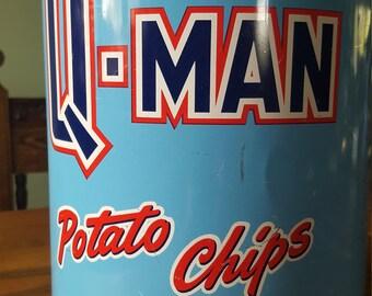Advertising tins, round, Q-Man