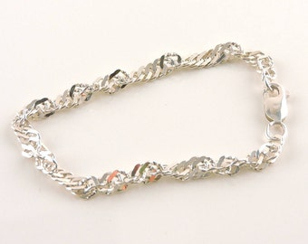 "Sterling Silver Twisted Cuban Link Bracelet 6 3/4"" (5.5 grams)"