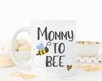 Mommy to bee.Pregnancy announcement.We're pregnant!.New mom.Mom coffee mug.Coffee mug.Coffee cup.Dishwasher + microwave safe.