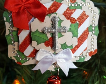 Red stripes and holly, sparkly silver cross Christmas ornament
