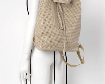 Leather perforated beige string backpack