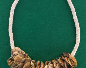 Kumihimo necklace decorated with polished shell