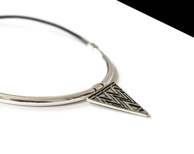 Small triangle silver necklace.